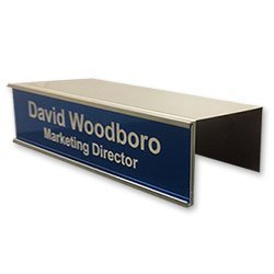 Cubicle name plate holders for offices easily slide over any cubicle wall and move anywhere without damaging the fabric wall. Many sizes, colors and options. NapNameplates.com