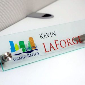 Acrylic nameplates for offices printed in full color with a unique stand - Napnameplates.com