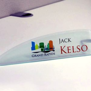 Designer acrylic name plates for offices have a unique shape and stand - Napnameplates.com